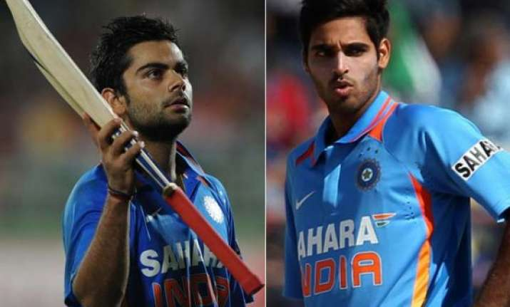 virat kohli bhuvneshwar kumar move up in icc rankings