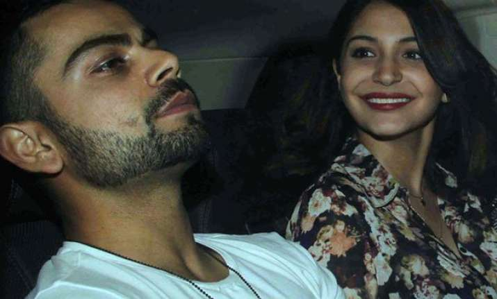 team india members arrive home kohli anushka land in mumbai