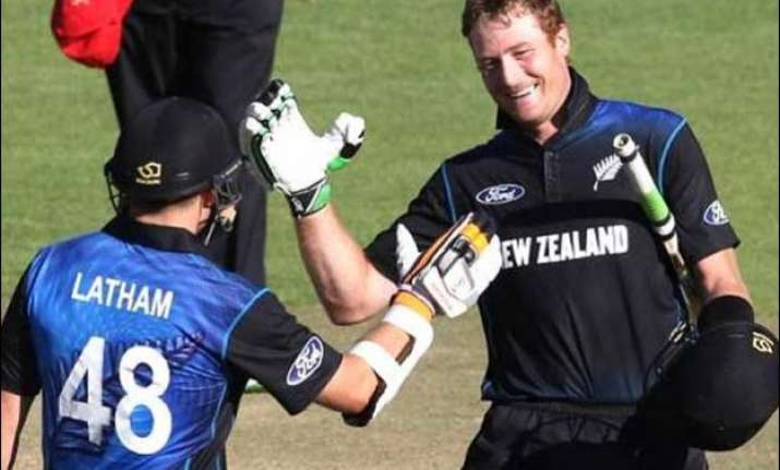 centuries by guptill and latham help new zealnd defeat
