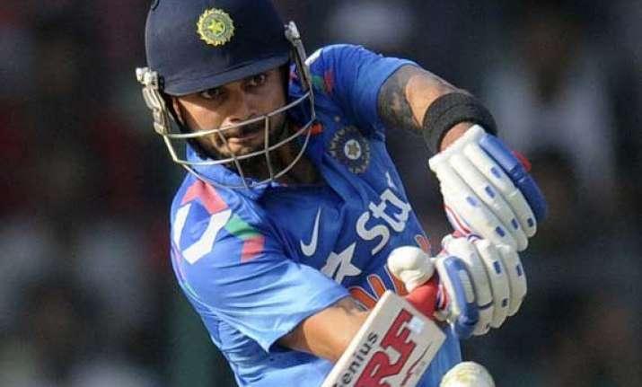 ind vs wi kohli raina take india to 263/7