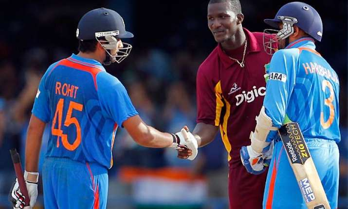 rohit steers india to four wicket win over wi in 1st odi