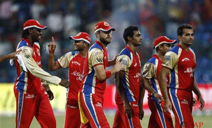 kohli gayle lead rcb to 26 run win over pune