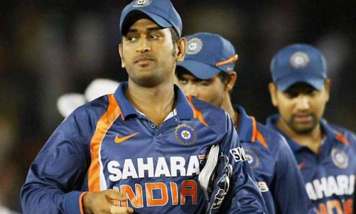 modest dhoni leads by example for expectant india