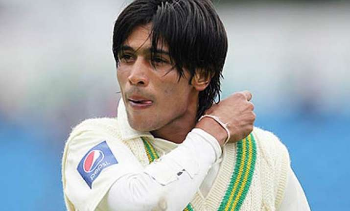 mohd aamer returns home says will appeal against ban