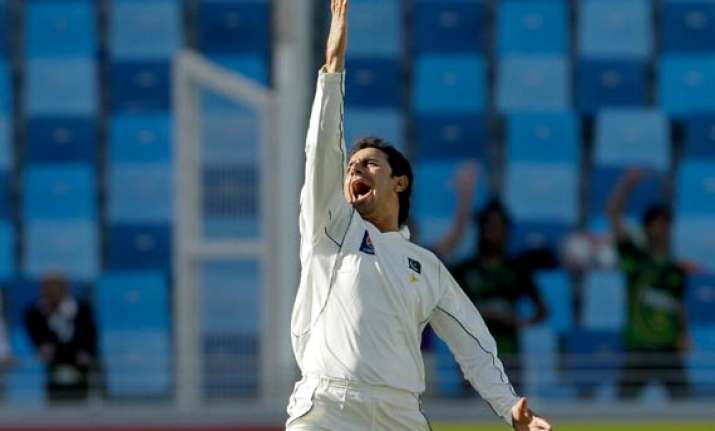 pakistan s ajmal rises to world s highest ranked spinner