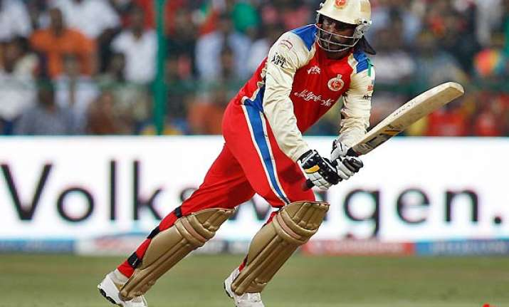 gayle helps rcb thrash csk to finish on top of league table