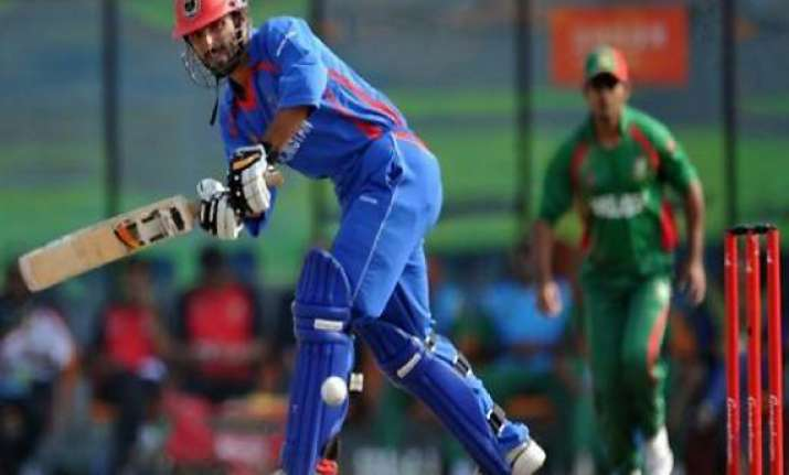 refugee to role model for afghan cricket skipper