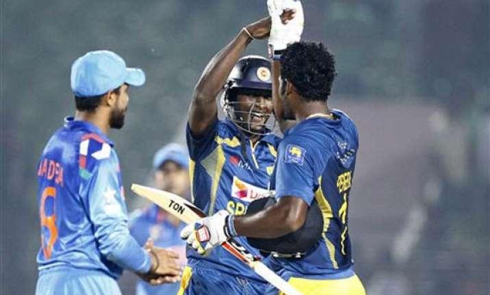 sangakkara hits ton as sri lanka beat india by 2 wickets