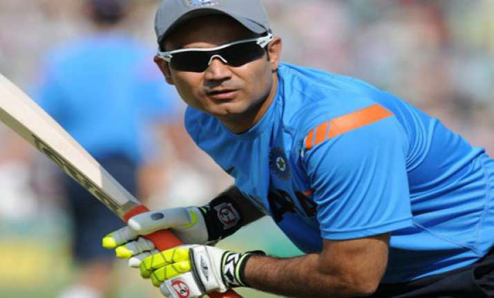 sehwag s stitches not a worry says coach dahiya