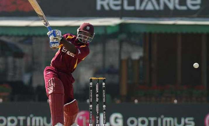 smith powell stand sets up west indies win over ireland