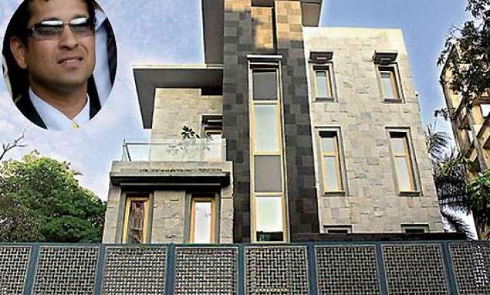 tendulkar pays penalty gets oc for his dream bungalow