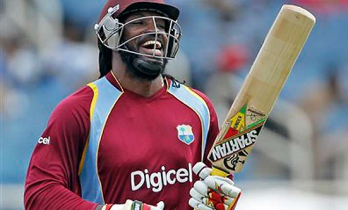 tri series gayle hits a ton west indies beat sri lanka by 6