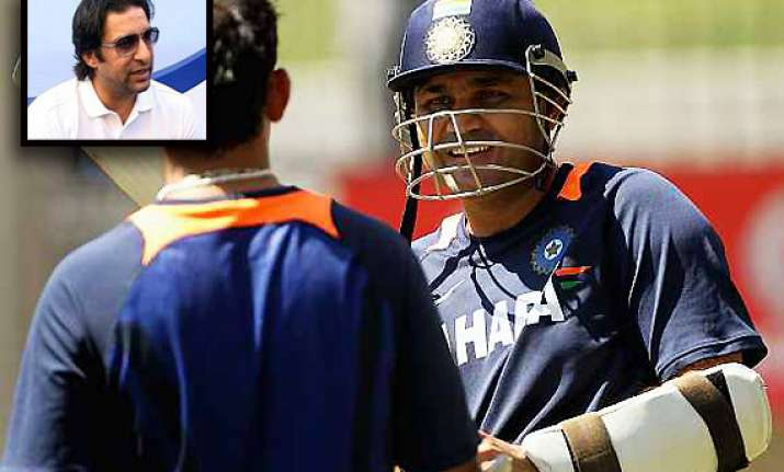 wasim akram backs dhoni says sehwag doesn t qualify as