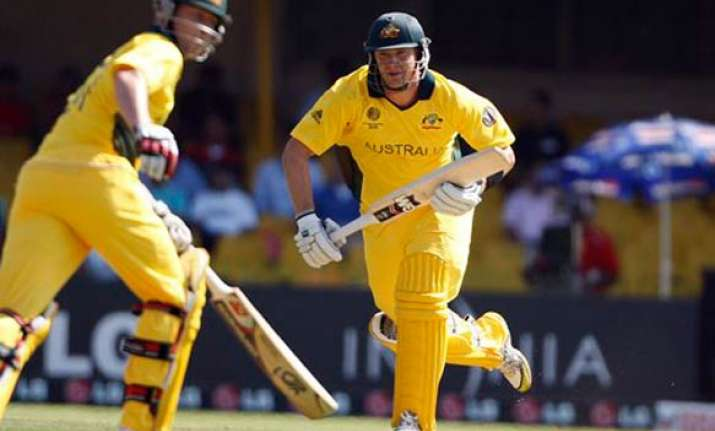 australia commence title defence with emphatic win over zim