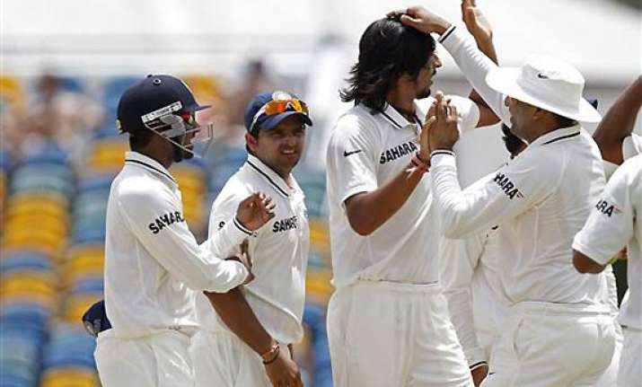 rain plays spoilsport on 2nd day after ishant s double