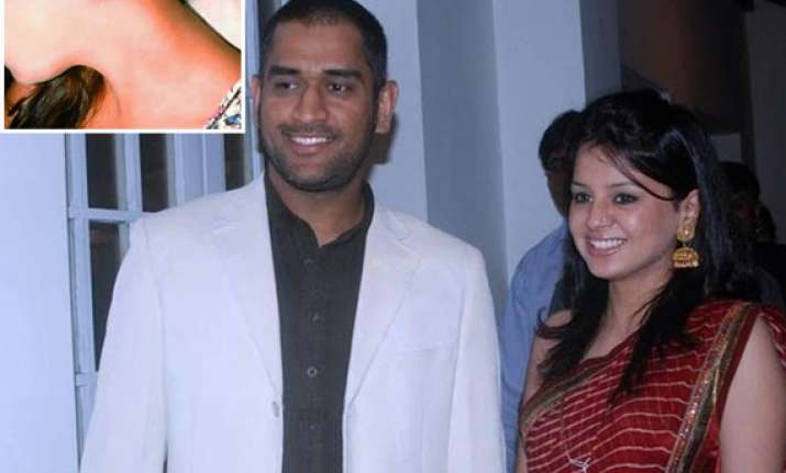 wife sakshi gets mahi tattoo on her neck