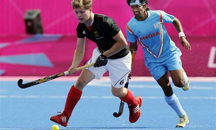 champions hockey india lose to germany but top group