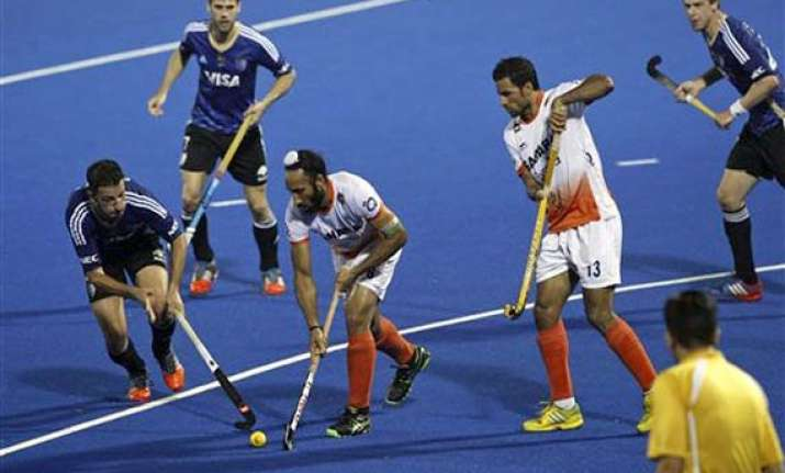 champions trophy india go down 2 4 to argentina