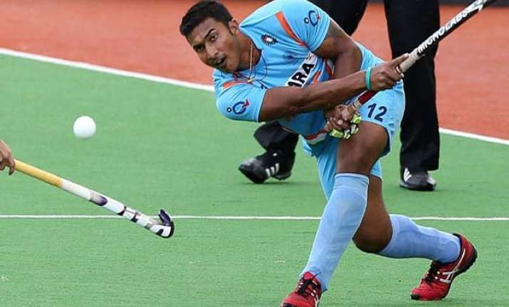 rusty india play 1 1 draw with japan in first hockey test