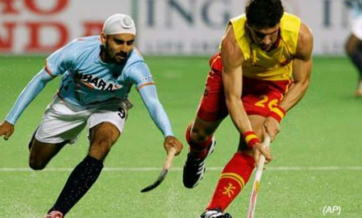 india s semifinal hopes diminish after defeat against spain