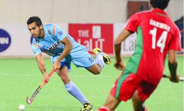 hockey midfielder dharamvir reaches 100 international cap