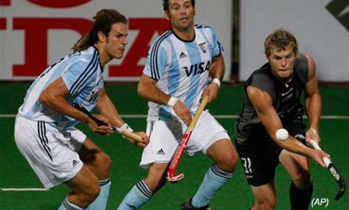argentina register first win in hockey world cup