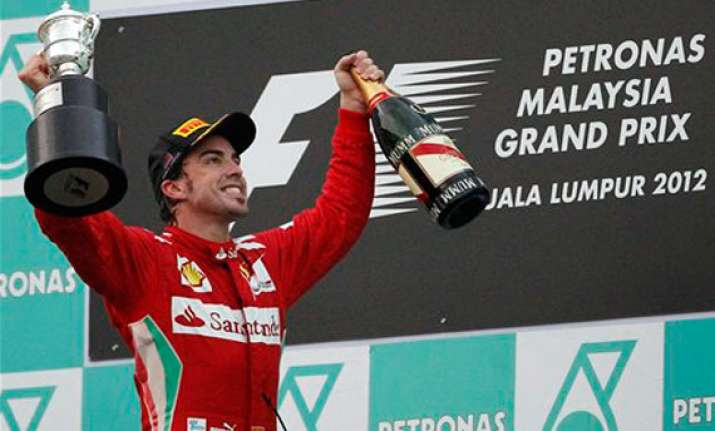 alonso wins action packed malaysian grand prix