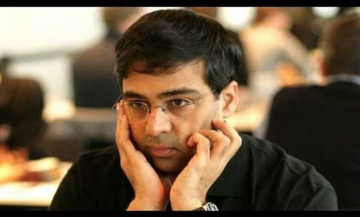 anand falls behind in world blitz after three losses on day