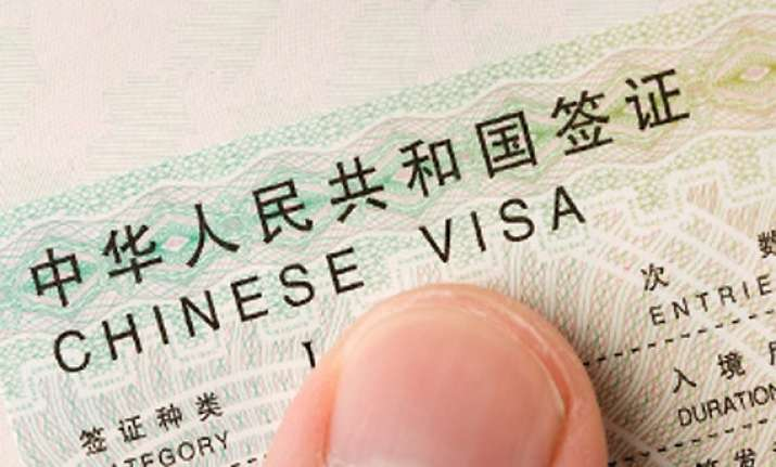 beijing defends stapled visas says policy consistent and