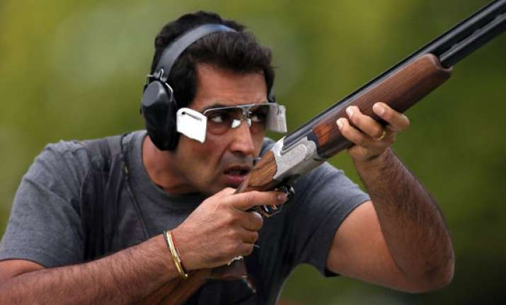 cwg 2014 manavjit singh sandhu wins bronze in trap event