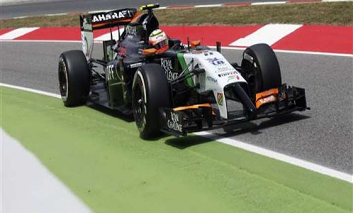 force india finish 9th 10th in spain