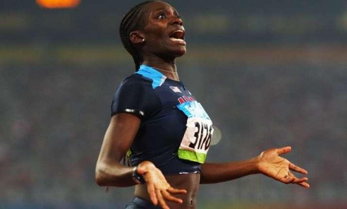 harper wins 100 meter hurdles