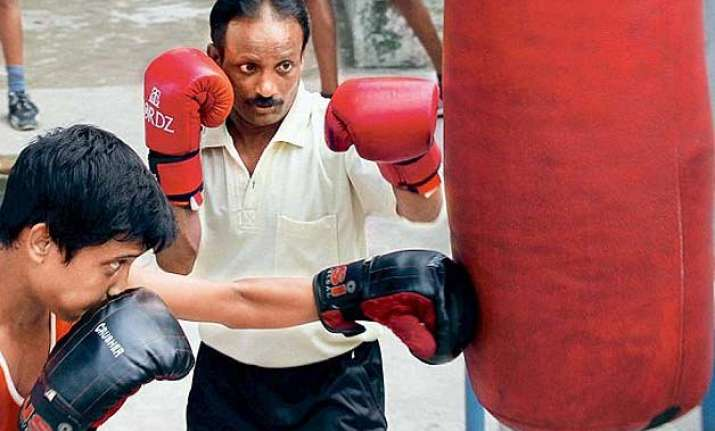 sweeper boxer seeks a job of dignity from mamata govt