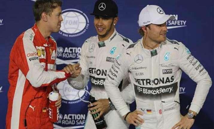 hamilton takes pole position for bahrain gp ahead of vettel