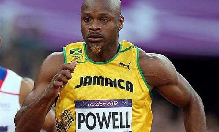 jamaican sprinter asafa powell runs fastest 100m this year