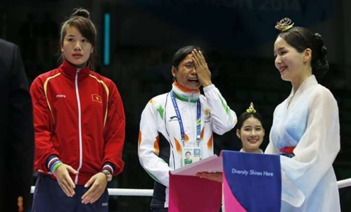 asian games boxer sarita devi refuses to wear bronze medal