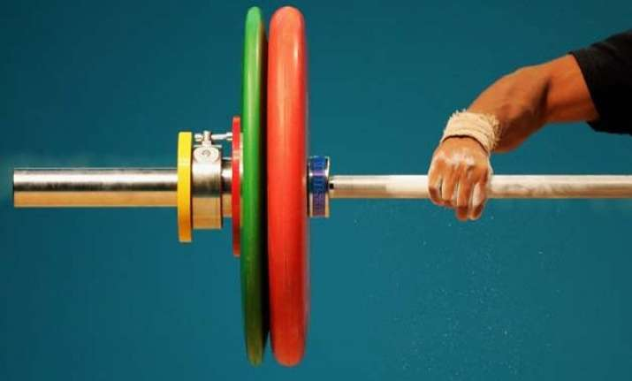 eight weightlifting coaches handed two year suspension