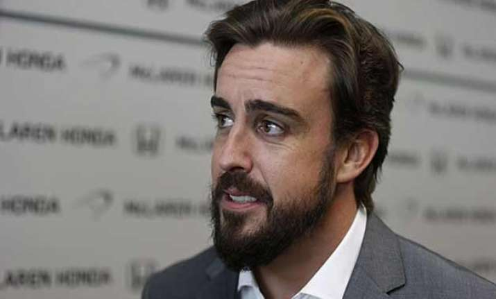 fernando alonso aims to return in malaysian grand prix