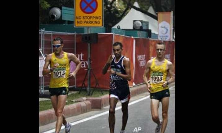 harminder wins bronze in men s 20km walk event