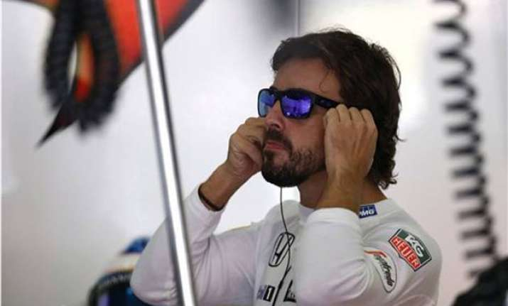 mclaren s woes continue as brake failure ends alonso s race