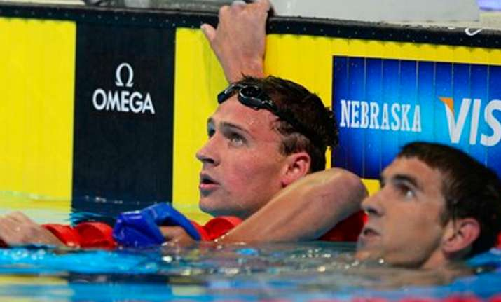 lochte beats phelps in 1st showdown at trials