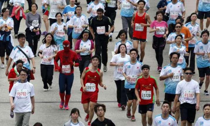 maisei demissie win hong kong marathon titles