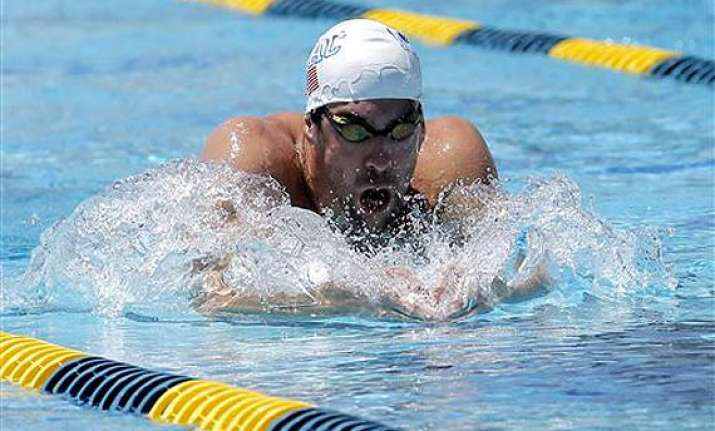 michael phelps having fun in his return to swimming