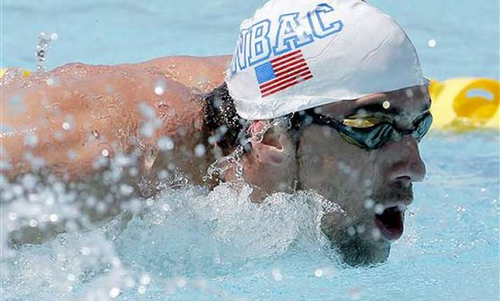 michael phelps loses to lochte in comeback meet