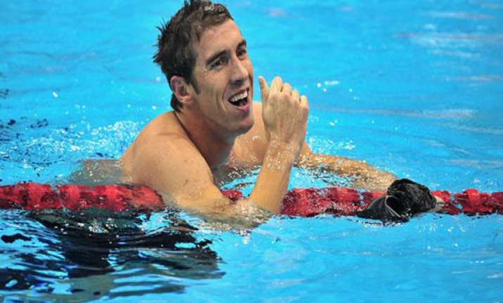 phelps back in action but mum on comeback