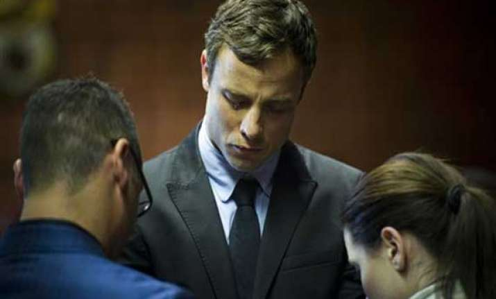 pistorius says he mourns for girlfriend he killed