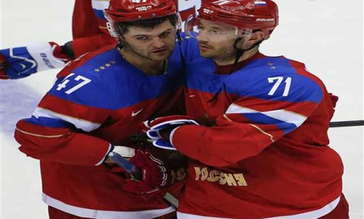 russia forced into must win hockey game