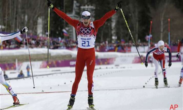 sochi olympics dario cologna wins men s 30k skiathlon