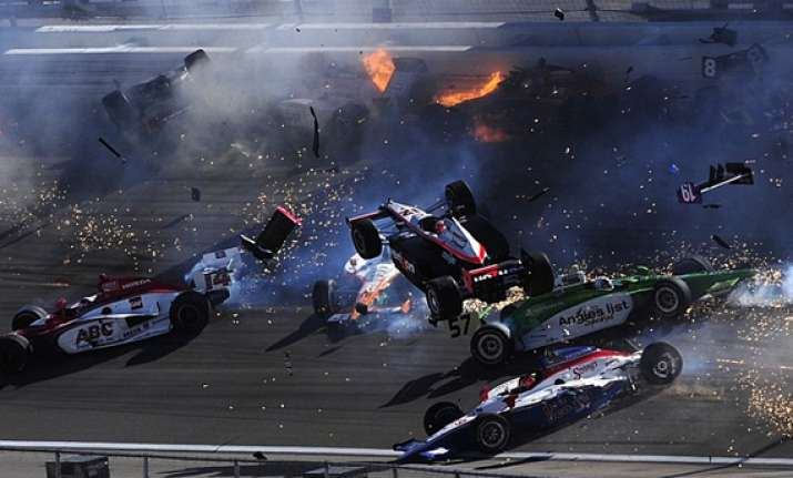 terrifying pics as indycar champion dies in ball of flames