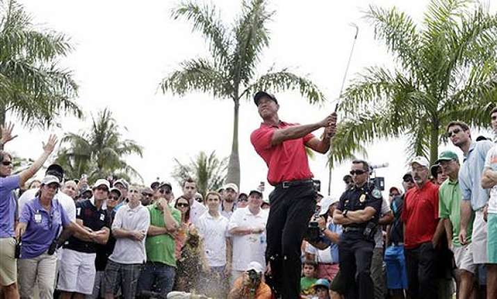 tiger woods pulls out of bay hill because of back pain.